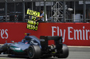 Nico Rosberg passes his pit board