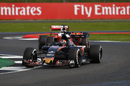 Daniil Kyat fights a position with Sebastian Vettel