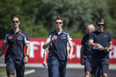 Daniil Kvyat walks the track with his engineers