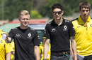 Kevin Magnussen and Esteban Ocon walk the track