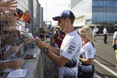 Jenson Button signs autographs for the fans