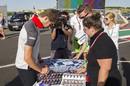 Romain Grosjean signs autographs for the fans