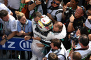 Lewis Hamilton celebrates with his team in parc ferme