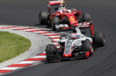 Romain Grosjean leads Kimi Raikkonen