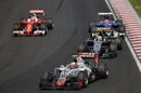 Kimi Raikkonen passes Esteban Gutierrez