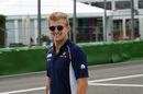 Marcus Ericsson walks through the paddock