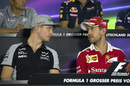Nico Hulkenberg speaks with Sebastian Vettel during the press conference