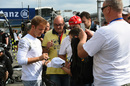 Nico Rosberg signs autographs for a fan
