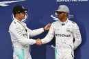 Nico Rosberg and Lewis Hamilton shake hands in parc ferme after qualifying