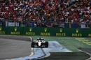 Lewis Hamilton rides the kerb
