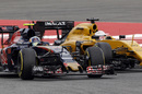 Carlos Sainz battles for a position with Kevin Magnussen