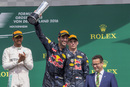 Daniel Ricciardo celebrate on the podium with the trophy