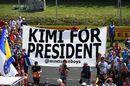 Kimi Raikkonen fans shows a banner of