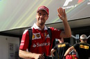 Sebastian Vettel waves a hand with smiling