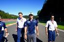 Felipe Nasr walks the track with his engineers