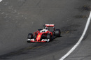 Sparks fly from Sebastian Vettel's Ferrari