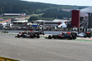 Sergio Perez and Jenson Button run wide at the start of the race