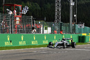Nico Rosberg takes the chequered flag