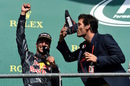 Mark Webber drinks champagne from Daniel Ricciardo's boot