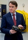 Lord Mandelson holds a car's nose tip during a visit to the Williams factory