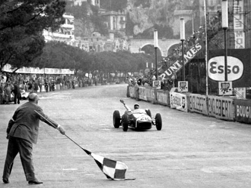 Race winner Stirling Moss celebrates in Monaco