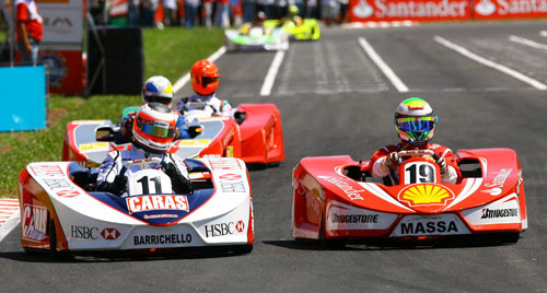 Rubens Barrichello and Felipe Massa vie for position in karts