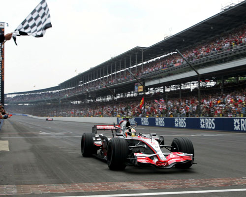 Lewis Hamilton takes the chequered flag