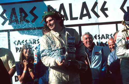 Nelson Piquet celebrates his fifth place that confirmed him as world champion after the Caesars Palace GP