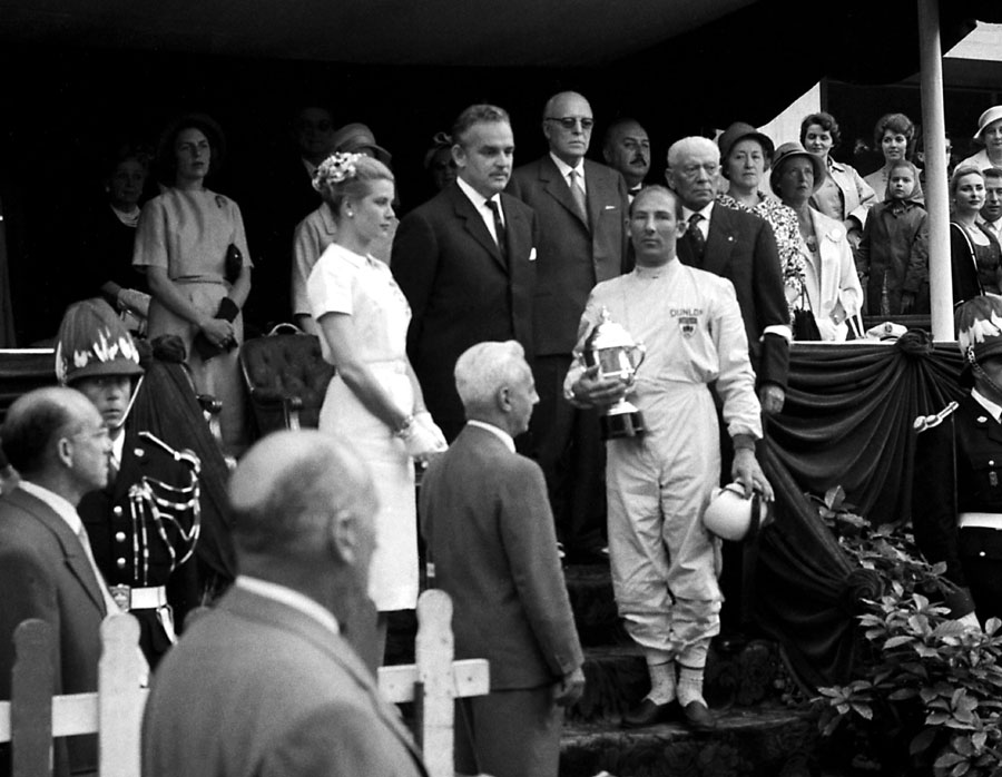 Stirling Moss collects the trophy from Prince Rainier and Princess Grace of Monaco