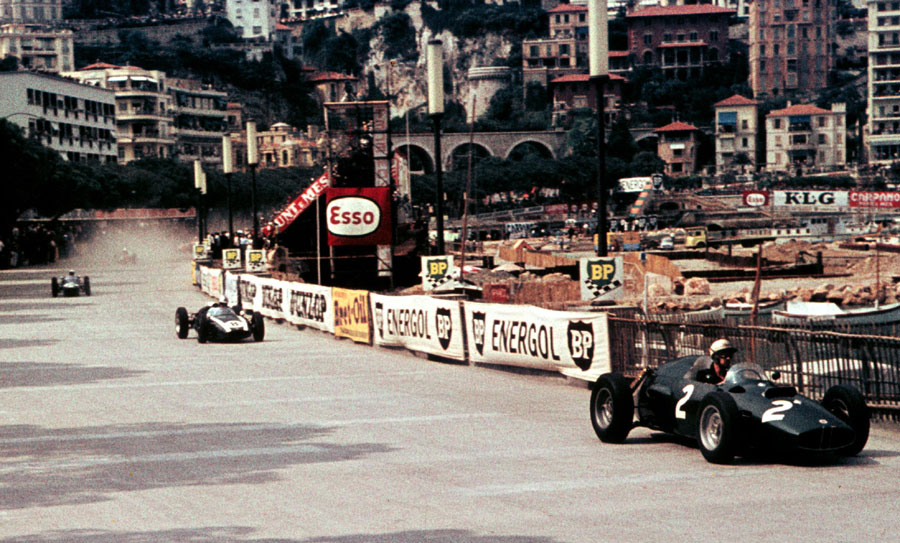 Jo Bonnier leads Jack Brabham with Stirling Moss in third