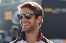 Romain Grosjean smiles in the paddock