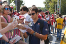 Felipe Nasr signs autographs for fans