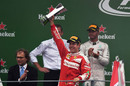 Sebastian Vettel celebrates on the podium with the trophy