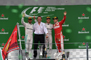 Nico Rosberg, Lewis Hamilton and Sebastian Vettel acknowledge the crowd during a podium ceremony