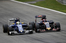 Marcus Ericsson battles for a position with Daniil Kvyat