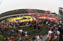 Fans and giant Ferrari flag on the track after the race