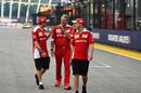 Sebastian Vettel, Kimi Raikkonen and Maurizio Arrivabene walk the track