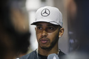 Lewis Hamilton speaks with media