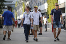 Marcus Ericsson and Felipe Nasr walk through the paddock