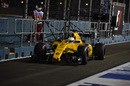 Kevin Magnussen makes his way down the pit lane