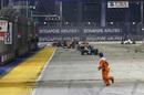 Marshal still on the track at the restart