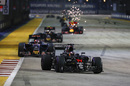 Fernando Alonso leads Daniil Kvyat