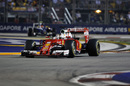 Sebastian Vettel works hard to keep its pace