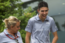 Esteban Ocon walks through the paddock
