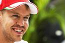 Sebastian Vettel looks on in the paddock