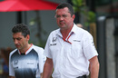 Eric Boullier walks through the paddock