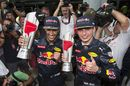 Daniel Ricciardo and Max Verstappen celebrate with the trophies