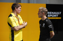 Kevin Magnussen talks with his race engineer