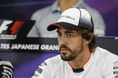 Fernando Alonso looks on during the press conference