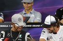 Lewis Hamilton and Fernando Alonso chat during the press conference